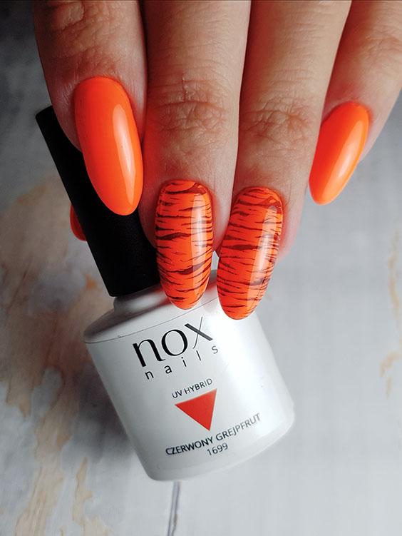 Neonowe pomarańczowe paznokcie hybrydowe